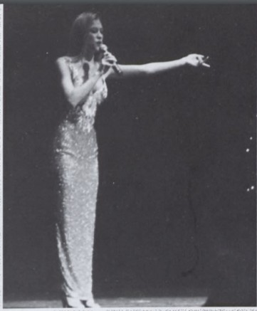 Figure 10: Iris Fagundo Lights Up the Stage with her Glittery Evening Gown
